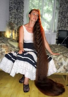 The woman, Tatiana, is 43. She is married and has two sons. Her hair length is 2 meters 30 cm.