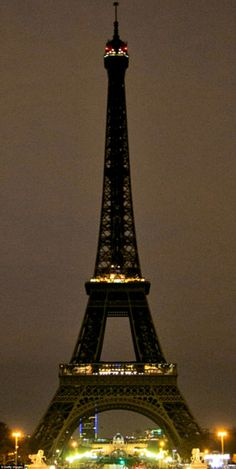 In the French capital the lights on the Eiffel Tower, which has been closed indefinitely in the wake of the attacks, were dark