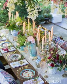 A lush tablescape with gilded accents. It takes it to another level by playing with textured fabric and hand-painted ceramics!
