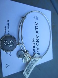 NEW with Tags RETIRED Alex and Ani Initial Silver Letter F Charm Bangle. Get the lowest price on NEW with Tags RETIRED Alex and Ani Initial Silver Letter F Charm Bangle and other fabulous designer clothing and accessories! Shop Tradesy now