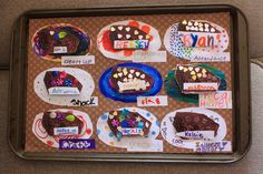 Girl Scout Brownie Kaper Chart. We put heavy duty magnets on the back of the brownies and rotate them. Everything is attached to an old baking sheet. The girls did a great job decorating them! It turned out cute. :-)