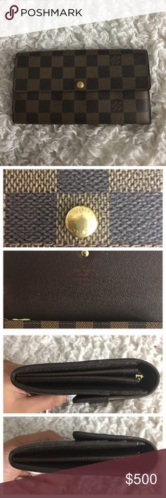 LOUIS VUITTON Portefeuille Sarah Bifold Wallet Preowned authentic LOUIS VUITTON Portefeuille Sarah Long Bifold Wallet. Bought a few years ago. Lining on the sides are peeling off. Besides that, still in good condition. Gold bottom in the front is scratched due to wear. Zipper works perfection fine. Exterior is in good condition. Hardly any scratches. Interior is also in good condition. Just a bit dusty. Serial number is found inside: SD0038. Only selling the wallet. Does not come with box or…