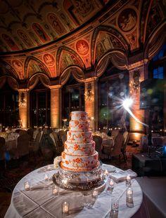 Pretty orange wedding cake in The Circle.