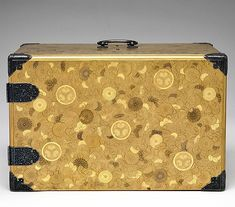 Portable Writing Cabinet with Tokugawa Family Crests, Chrysanthemums, and Foliage Scrolls, Kōami School, Lacquered wood with gold and silver takamaki-e, hiramaki-e, and applied gold foil on nashiji ground, Japan. Late 17th century. It was produced for the Tokugawa family in one of their official maki-e workshops, probably that of the Kōami family.