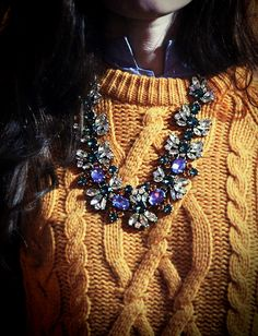Love layering button ups with chunky cable knits. Add a statement necklace and you have an easy go-to look for class.
