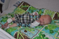 I made the quilt, not the precious grandbaby :) I tied the quilt and finished the edges with brown ric rac