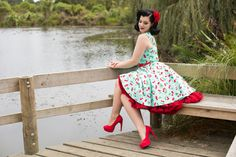 Elizabeth J Photography Miss Victory Violet pinup blue dress with red trim sitting