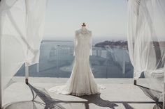 Lace wedding dress, luxury wedding dress, Santorini weddings, Santorini wedding venue, Santorini wedding photographer, Greece wedding, wedding in Greece, Santorini florist, Santorini flowers, wedding décor Greece, greek style wedding, Grecian wedding, greek island wedding