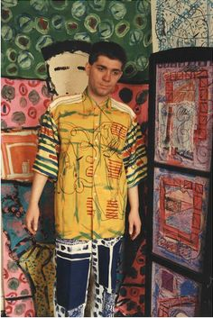 Damian Le Bas with his artwork, 1984.    -  #fashion #style #tshirt #shirt #tee #menstshirt #graphictee #prints #fashionphotography #clothing #apparel #streetstyle #menswear #mensfashion #mensstyle #couture #lookbook #wear #wearable #stylish #streetwear #fashiondetails #Accessories #costume #garment #studio #shop #Wardrobe #shoppingonline #onlinestore #stylist #pattern #wearableart #textile #fabric #art #artist #illustration #drawing #artwork