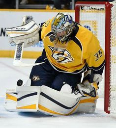 NASHVILLE, TN - OCTOBER Pekka Rinne of the Nashville Predators tries to control a rolling puck against the Carolina Hurricanes during the second period at Bridgestone Arena on October 2015 in Nashville, Tennessee. (Photo by Sanford Myers/Getty Images) Predators Hockey, Carolina Hurricanes, Field Hockey, Hockey Players, Ice Hockey, Espn, October 8, Two By Two, Nhl 2016