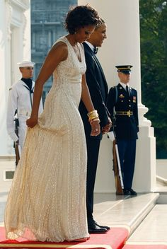 President Barack Obama and First Lady Michelle Obama./wow at that dress