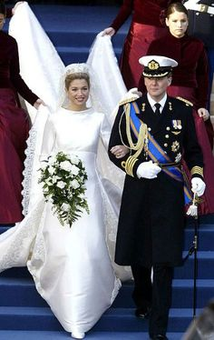 Dutch Crown Prince Willem-Alexander's argentine bride Maxima Zorreguieta (now Princess Maxima of the Netherlands) wore an ivory mikado silk gown with a high neck by Valentino for their wedding in 2004.
