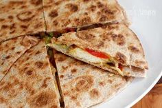 Chicken Quesadillas - use chicken with fajita spice, peppers, cheese and salsa or other chutney / relish.