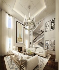 §Great high ceilings, lighting, wall art, rug and staircase zigzagging in the background...