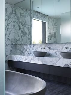 Cool to the eye, all-marble bathrooms are making a splash, from sinks to counters to showers to tubs. We are particularly enamored with the David Collins Studio-designed model lounge for the MahaNa