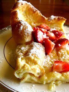 "Puffy German Pancake - My recipe 3 eggs, 5 egg whites, 1 1/4 c milk, 1 c flour, 1/4-1/3 c sugar, 1 t vanilla, 3 T butter,   Bake 425 degrees, 18 minute in my large ceramic Corningware dish (10""x10"").  Serve with sour cream and strawberries"