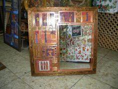Espejo enmarcado sobre madera y decorado con decoupage, pasta dimensional, acrílicos y plomo.