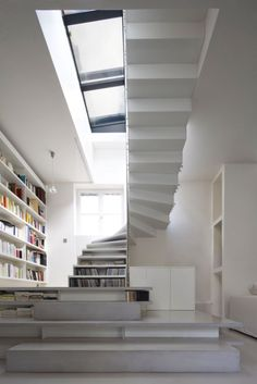 Elegant curves and a cool palette make this open-ended bookcase/staircase irresistible to the design-savvy eye.