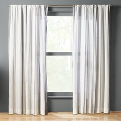 Shop wide stripe curtain panel.   Warm ivory backgrounds a full-length series of top-to-bottom stripes in a shade of soft black.  100% cotton fabric is sheer enough to filter light and still create some privacy.