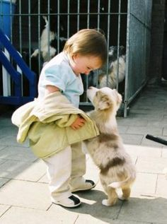 Kids and puppies!  It does not get much sweeter than this