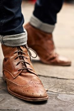 wingtip. boots. cuffed jeans.