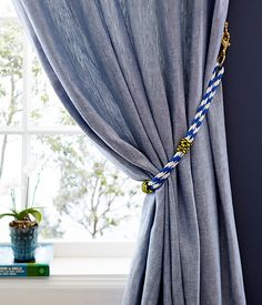 Create a curtain tieback with pattered rope from the hardware store! Learn how on our Style Blog: https://www.onekingslane.com/live-love-home/ropeprojects/