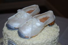 Very special cake for my Mother on her 80th birthday.  White cake with buttercream frosting.  The shoes are all fondant.  She still teaches line dancing and clogging!!