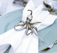 "Octopus Napkin Ring Pewter Octopus Napkin Rings are delicately detailed; the octopi have curled tentacles with realistic suckers, beautifully pebbled skin and wise, soulful eyes. Size: 3.5"" W x 2.25"""