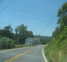 a country church alongside a country road