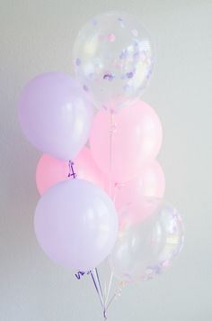 Sweet pink and purple balloons with confetti filled ones to break it all up.