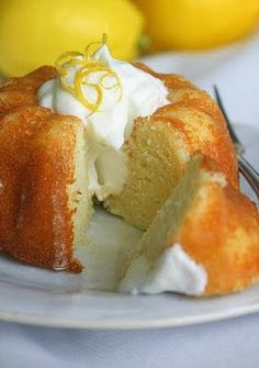 Lemon Yogurt Bundt Cake with Limoncello Glaze - Ultra moist and very tender, this cake falls on the texture spectrum somewhere between a butter cake and a soft pound cake. You can make these as 12 mini-bundts, or as one large full-size bundt if you're in big cake mood