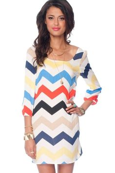 Rainbow chevron 3/4 sleeve dress via Toni.com looks to be a throw back to the 60/70's  very cute!!  Rainbow by darlene_j