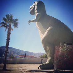 """Also known as Claude Bell's dinosaurs, the #cabazondinosaurs are just west of Palm Springs. Many of @korakia guests stop and visit this epic roadside attraction, originally sculpted by artist Claude Bell to generate more visitors to the nearby Wheel Inn Restaurant (now closed). It has since become a destination in its own right, featured in many 80s movies like Pee Wee's Big Adventure, National Lampoon's Vacation, and the Wizard, as well as the music video for Tears for Fears' """"Everybody…"""