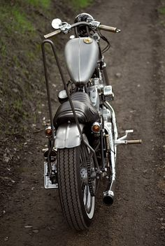 my 2007 rubber mount carbed EVO sportster lane splitter. an ode to old school choppers styling with modern technology. this little rigid bobber is garage built & ridden daily by yours truly.