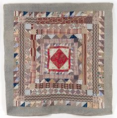 Date: 1865 - 1875 This multicoloured frame quilt features a Turkey Red Paisley print central square set on point Old Quilts, Antique Quilts, Small Quilts, Mini Quilts, Vintage Quilts, Scrappy Quilts, Quilting Frames, American Quilt, Sampler Quilts