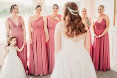 mismatching pink bridesmaid dresses from Kennedy Blue! This beautiful bride is doing a first look with her Rosewood pink bridal party wearing Kennedy Blue bridesmaid dresses! Shop all Rosewood pink bridesmaid dresses today! And find more wedding ideas and bridesmaid dress inspiration on our Instagram! | chic bridal hairstyles | unique wedding pictures | 2022 wedding ideas | first look pictures | affordable bridesmaid dresses Affordable Bridesmaid Dresses, Mismatched Bridesmaid Dresses, Wedding Dresses, Wedding Pictures, Wedding Ideas, Bridal Hairstyles, Party Looks, Beautiful Bride, Unique Weddings