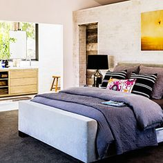 I've always liked the bed against a partial closet wall design. I only need to bump out another 10 feet to my house to make it work.