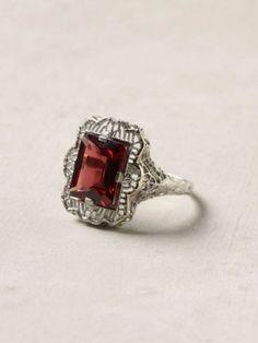 Garnet is such a romantic color.  Estate garnet filigree ring, $978, anthropologie.com