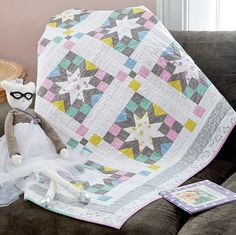Baby quilt patterns with gray in them are really popular! It's a neutral tone that works with any colorway. This sweet baby quilt called Estelle, by Wendy Sheppard, is a bit oversized for extra snuggling and uses great fabrics and color choices!