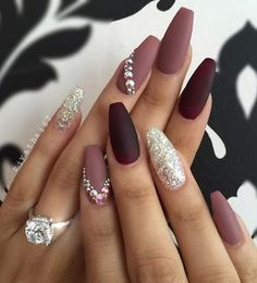 Here are nails done in various shades of purple. A special seal leaves the glitter gel on one nail of both hands.
