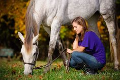 Horse eating grass while girl owner squatting beside it. Annapolis Kent Island Maryland High School Senior Portrait Photography with Horse Pet by photographer Leo Dj