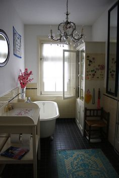 Yellow tile. Clawfoot tub.
