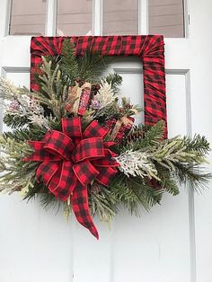 Red Buffalo plaid frame with beautiful Christmas Pine for your front door MJ Keep up until you replace with one of my Spring wreaths! Made by Designs by Debby Ohio. Keep checking back, I add new wreaths daily! The reactions have been fabulous! Decoration Christmas, Noel Christmas, Xmas Decorations, Christmas Ornaments, Christmas Swags, Christmas Music, Diy Christmas Arrangements, Frame Decoration, Christmas Cards