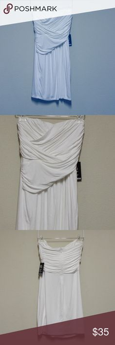 """Express Strapless Dress. MAKE AN OFFER!!! Express NWT dress Size Small No rips, stains, or tears Strapless Armpit to Armpit: 16""""  Total Length 27""""  95% Rayon, 5% Spandex. Express Dresses Strapless"""