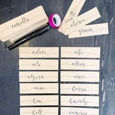 Kraft calligraphy place cards with centred names