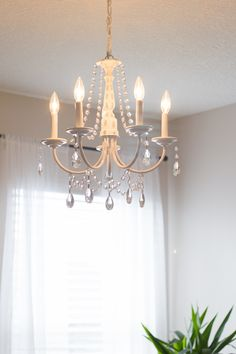 DIY Crystal Chandelier (easy tutorial),You can make your own DIY crystal chandelier. This site shows you how! Chandelier and chandelier - romantic and trendy at the same time Nobl. Plastic Chandelier, Old Chandelier, Modern Chandelier, Crystal Chandeliers, Painted Chandelier, Bedroom Chandeliers, Bubble Chandelier, Brass Chandelier Makeover, Tv Design