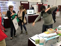 Visitors to our booth trying out the edtech tools we brought!