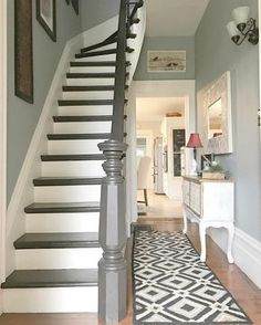 Entryway by Designs By Karan Walls are Benjamin Moore Piedmont Gray; trim is cloud white by Benjamin Moore; railing is General Finishes espresso gel stain. Stair Landing Decor, Staircase Landing, Staircase Design, Staircase Diy, Staircase Remodel, Painted Staircases, Painted Stairs, Grey Stain, Banisters