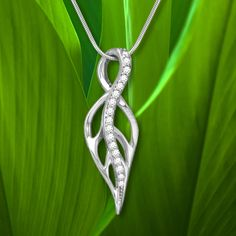 Maile Leaf Pendant with Diamonds in 14K White Gold:   In ancient times, only Ali'i (Hawaiian Kings and Queens) were allowed the honor of wearing beautiful fragrant Maile leis, and only during special or religious ceremonies. A Maile lei represents Aloha (Love), Ho'ohanohano (Honor), and Mahalo (Respect).
