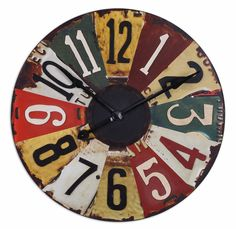 vintage license plates clock $184  i'd like it to spin like one of those carnival wheels.  :~)